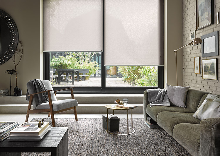 grey room with shades over floor-to-ceiling glass doors