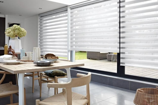 large window shades in a dining area
