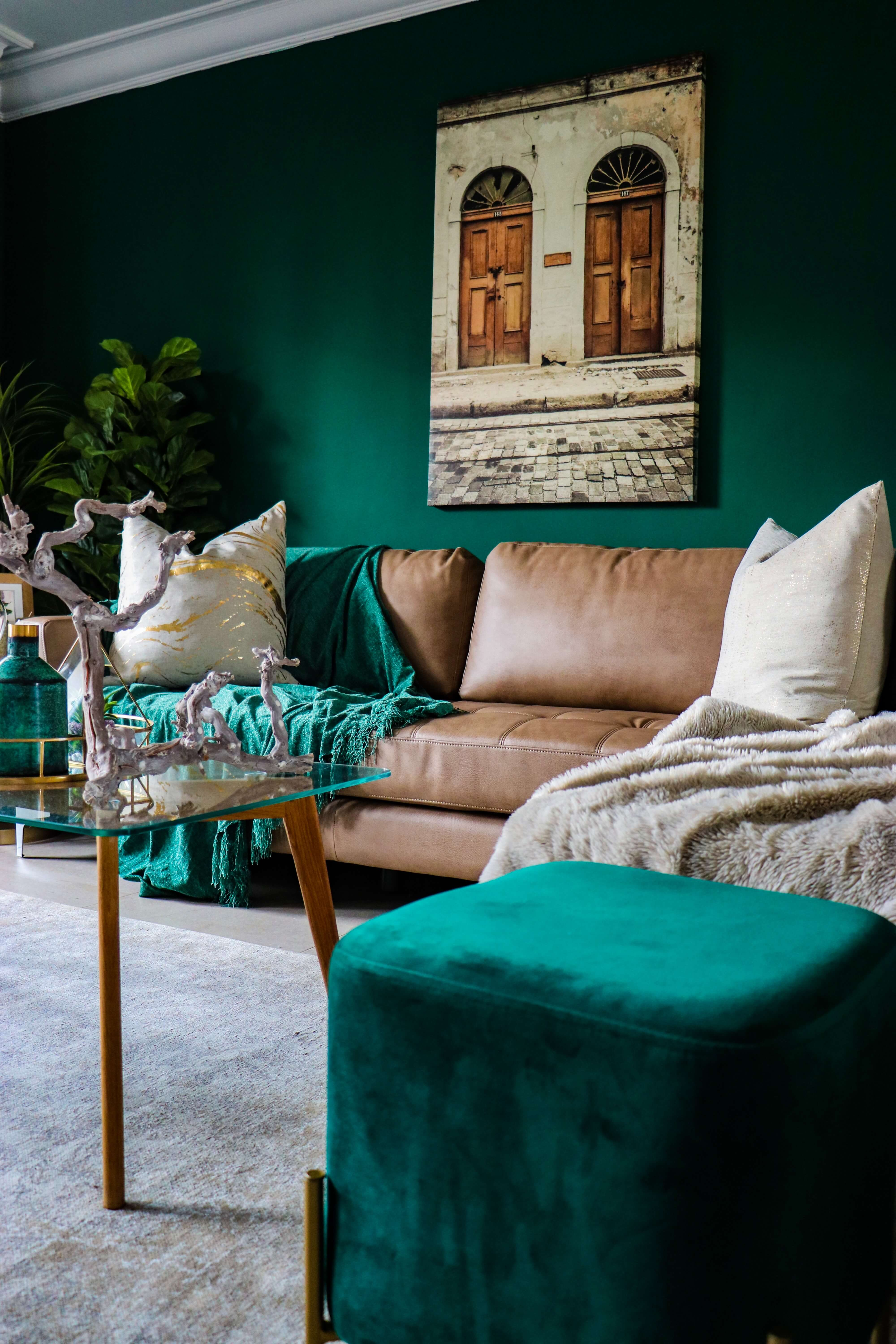 bold green cozy living room with plush pillows and fuzzy throws