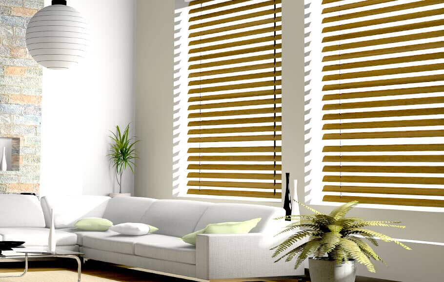 bamboo blinds that are closed in a room with a white couch