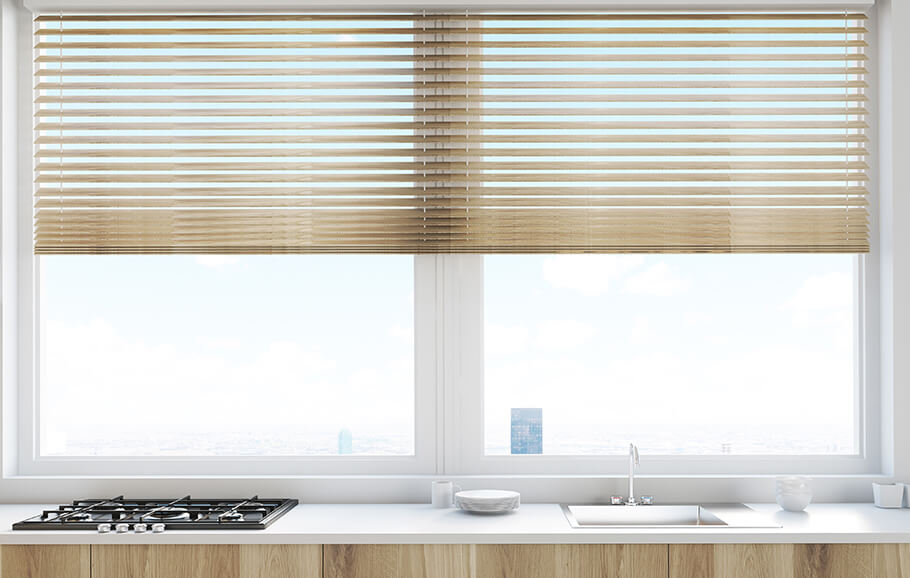 half opened blinds in a kitchen